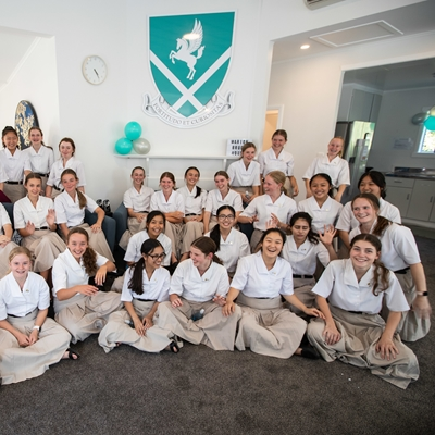 Girl students at King's College celebrate new house opening