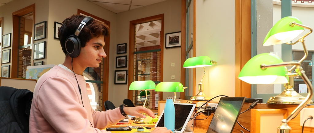King's College student engages in Distance Learning on his laptop